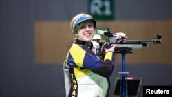 在女子氣步槍射擊賽中,19歲的美國選手斯拉舍贏得金牌。