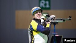 American shooter Ginny Thrasher took gold in the women's air rifle event in Rio, Aug. 6. 2016.