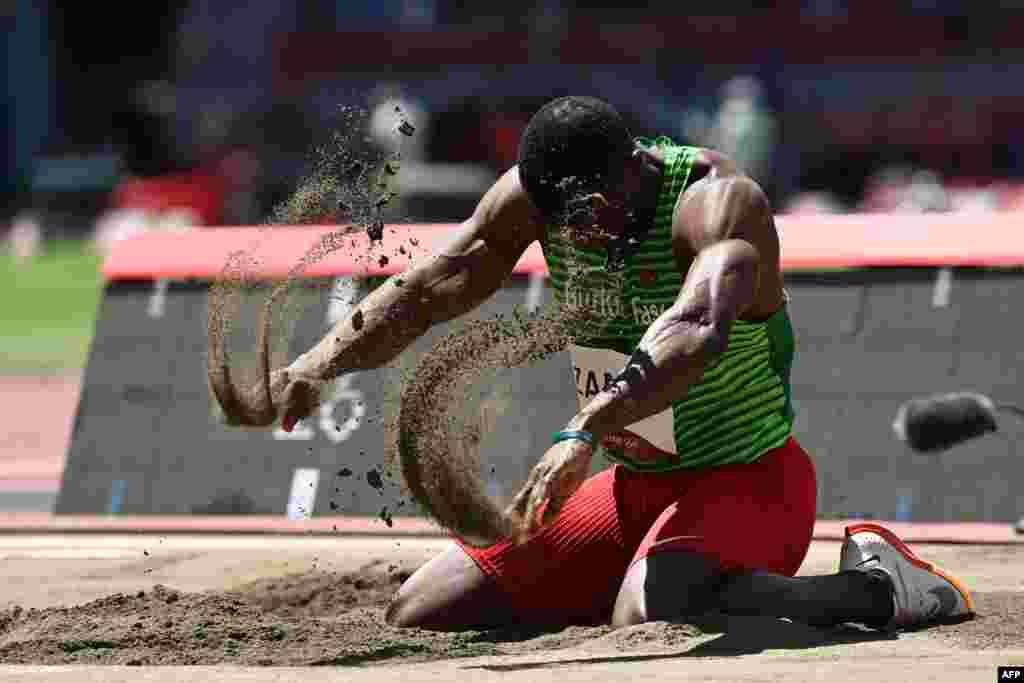 Burkina Faso's Hugues Fabrice Zango reacts as he competes in the men's triple jump final during the Tokyo 2020 Olympic Games at the Olympic Stadium in Tokyo on August 5, 2021. (Photo by Jonathan NACKSTRAND / AFP)