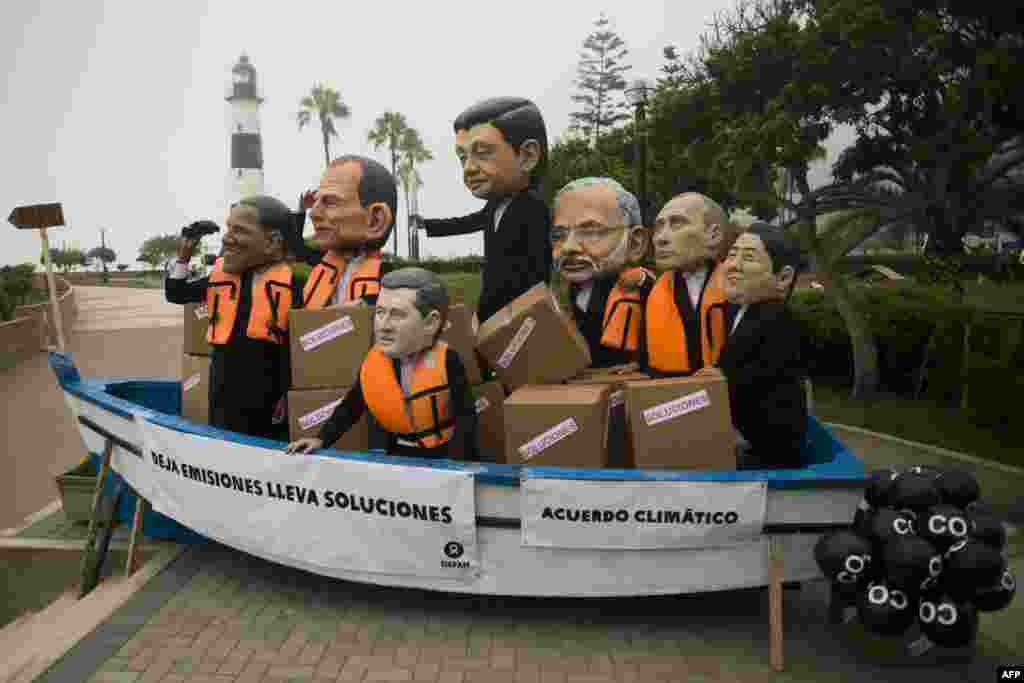 Activists depicting U.S. President Barack Obama, Australia's Prime Minister Tony Abbott, Canada's Prime Minister Stephen Harper, China's President Xi Jinping, India's Prime Minister Narendra Modi, Russia's President Vladimir Putin, and Japan's Prime Minister Shinzo Abe demonstrate on the sidelines of the U.N. COP20 and CMP10 climate change conferences being held in Lima, Peru.