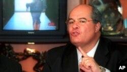 FILE - Then-political consultant Julio Ligorria speaks to reporters in Guatemala City, Guatemala, March 25, 2002.