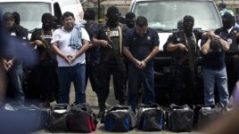 Nicaragua National Police present 18 foreigners believed to be Mexican nationals who posed as Televisa journalists, in Managua, Nicaragua, August 24, 2012.