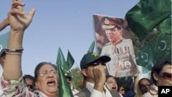 "Supporters of political party Pakistan Muslim League hold a picture of army chief Gen. Ashfaq Parvez Kayani in Karachi, Pakistan. Pakistan's intelligence chief, Gen. Ahmed Shuja Pasha, admitted ""negligence"" on the part of authorities in failing to find bi"