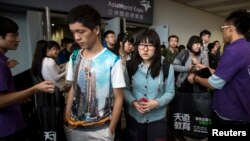 Students leave after a Scholastic Assessment Tests (SAT) exam at AsiaWorld-Expo in Hong Kong, Nov. 2, 2013.