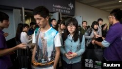 Students leave after a Scholastic Assessment Tests (SAT) exam at AsiaWorld-Expo in Hong Kong.