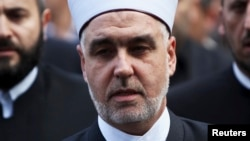 FILE - New elected Grand Mufti of Bosnia Husein Kavazovic arrives at an inauguration ceremony in front of the Gazi Husrev Begova mosque in Sarajevo, Nov. 15, 2012. Kavazovic is the 14th Grand Mufti of the Islamic Community in Bosnia and Herzegovina.