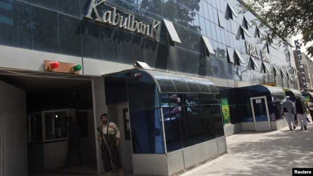 A security guard stands outside the main office of Kabul Bank, September 1, 2010.