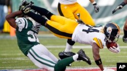 FILE - New York Jets free safety Jaiquawn Jarrett (37) tackles Pittsburgh Steelers' Antonio Brown (84) during the first half of an NFL football game in East Rutherford, New Jersey.