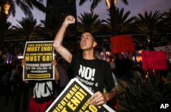 Nicholas Maldonado, 23, of San Pedro, protests outside of California Republican Convention in Anaheim, Calf., Oct. 20, 2017. Protesters have gathered outside a Southern California hotel where former White House adviser Steve Bannon gave the keynote speech at a state Republican convention.
