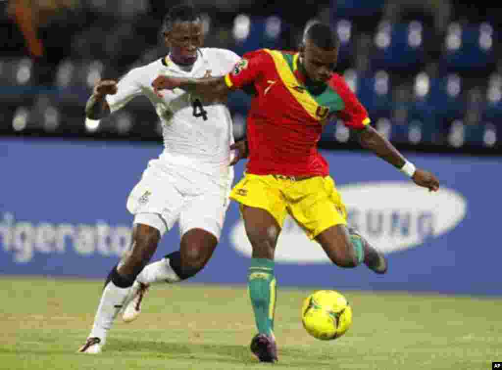 Guinea's Camara Abdoul Razzagui (R) kicks to score against Ghana during their African Cup of Nations Group D soccer match at Franceville stadium February 1, 2012.