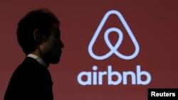 FILE - An Airbnb logo