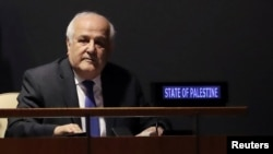 Palestinian Ambassador to the United Nations Riyad Mansour sits while members of the U.N. General Assembly vote on whether to allow the Palestinians to procedurally act like a member state during meetings in 2019, when they will chair the group of 77 developing nations, at the United Nations in New York, Oct. 16, 2018.