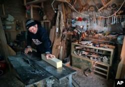 Nicolae Dascalu, 58, owner of a small carpentry company, works in Dambu, Romania, Dec. 8, 2016.