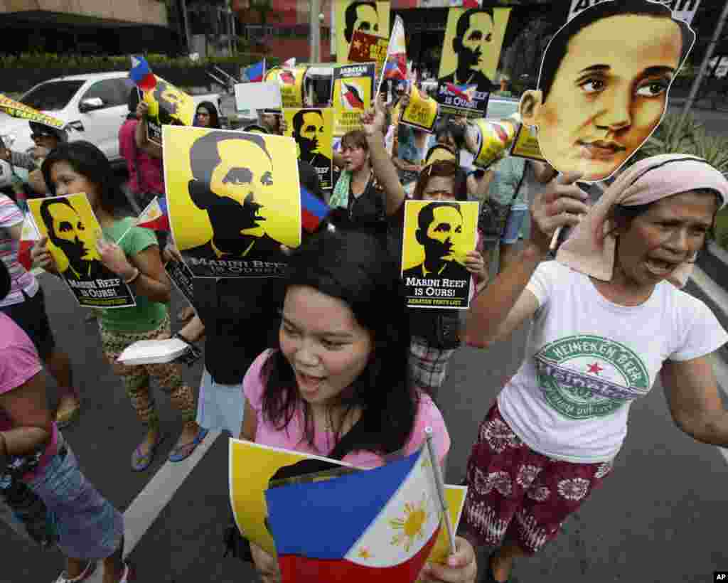 Protesters display placards showing national hero Apolinario Mabini, while shouting slogans outside the Chinese Consulate, Manila, June 12, 2014.