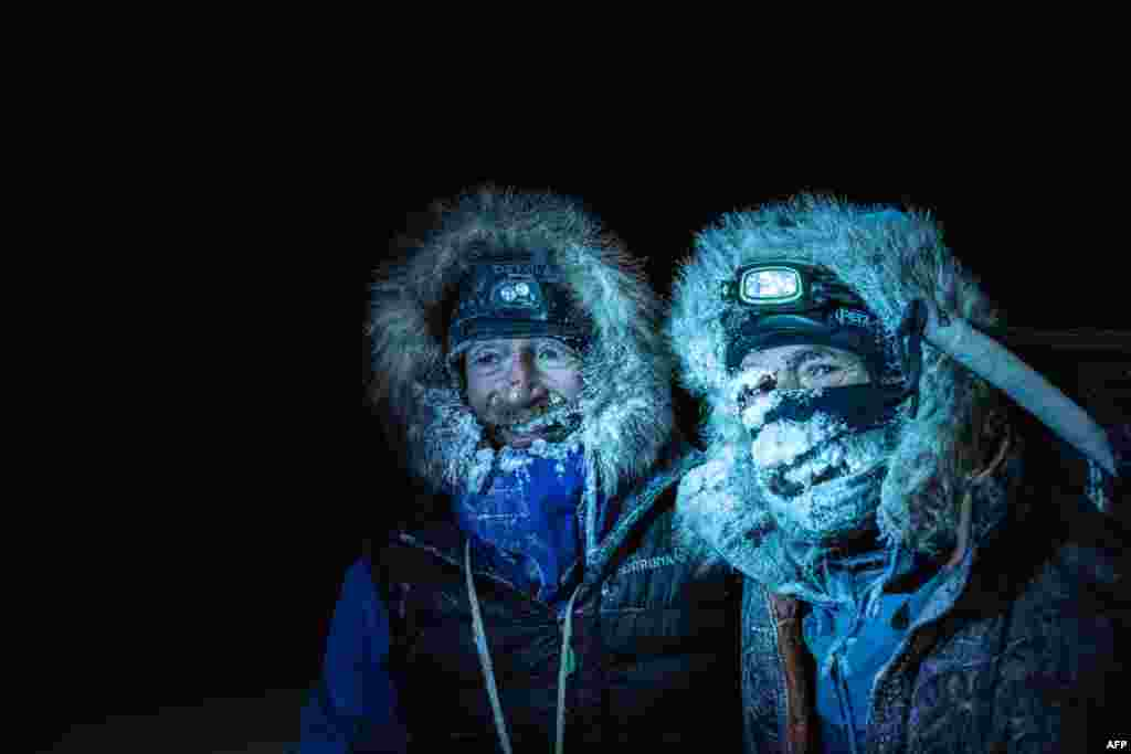 Picture handed out by the Mike Horn Sarl shows Borge Ousland (L) of Norway and South African-born Swiss Mike Horn posing as they arrive at the Lance icebreaker boat in Norwegian waters of the Arctic Ocean, after succesfully crossing the Arctic Ocean on skis.