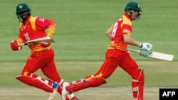FILE: Zimbabwe's batsman Ryan Murray (R) runs between the wickets with teammate Tendai Chatara (L) during the first one day international (ODI) cricket match between Pakistan and Zimbabwe at Queens Sports Club in Bulawayo on July 13, 2018.