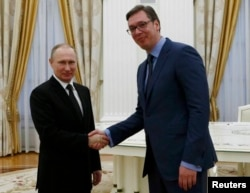 FILE - Russian President Vladimir Putin shakes hands with Serbian Prime Minister Aleksandar Vucic during their meeting at the Kremlin in Moscow, Russia, March 27, 2017.