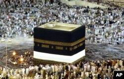 FILE - Pilgrims circle the Kabaa at the Great Mosque, Islam's holiest shrine, in Mecca, Saudi Arabia, Jan. 17, 2005.