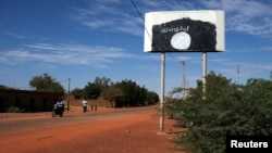 A sign for the radical Islamist group MUJAO is seen in Douentza, Mali, January 29, 2013.