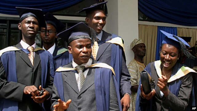 Students of the University of Ibadan check their graduation gowns at their campus in Ibadan, south west Nigeria (2006 file photo).