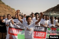 FILE - Supporters celebrate as they welcome Merera Gudina, leader of the Oromo Federalist Congress party, after his release from prison in Addis Ababa, Ethiopia, Jan. 17, 2018.