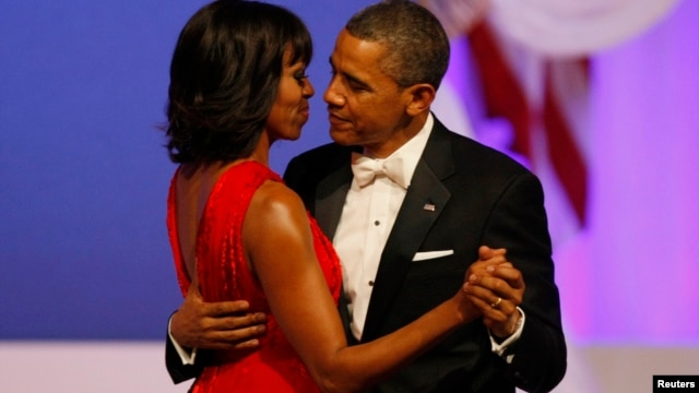 U.S. President Barack Obama and first lady Michelle Obama dance at the Commander in Chief's Ball in Washington, January 21, 2013.