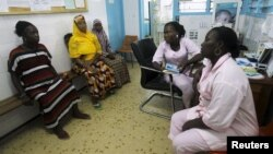 FILE - Midwives conduct consultations for pregnant women at the Treichville General Hospital, in Abidjan, May 5, 2015.