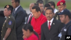 Venezuela's President Hugo Chavez (C) arrives at Simon Bolivar International Airport in Caracas, July 16, 2011
