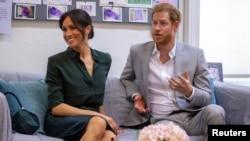 Pangeran Harry dan istrinya Meghan Markle.