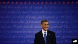 President Barack Obama smiles at moderator Jim Lehrer during the first presidential debate at the University of Denver, Oct. 3, 2012.