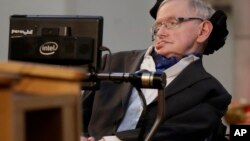 FILE - In this March 6, 2017, photo, Stephen Hawking receives the Honorary Freedom of the City of London. Cambridge University has put Hawking's doctoral thesis online, Oct. 23, 2017.