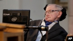 "FILE - In this March 6, 2017, photo, Stephen Hawking receives the Honorary Freedom of the City of London. Cambridge University has put Hawking's doctoral thesis online, Oct. 23, 2017. ""Properties of Expanding Universes"" explores ideas about the origins of"