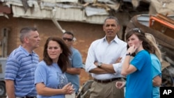 President Barack Obama views the devastation at Plaza Towers Elementary School caused by tornado and severe weather last week with school officials, May 26, 2013, in Moore, Oklahoma.