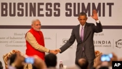FILE - U.S. President Barack Obama, right waves to the audience as he and Indian Prime Minister Narendra Modi attend the India-U.S business summit in New Delhi, India, Jan. 26, 2015.