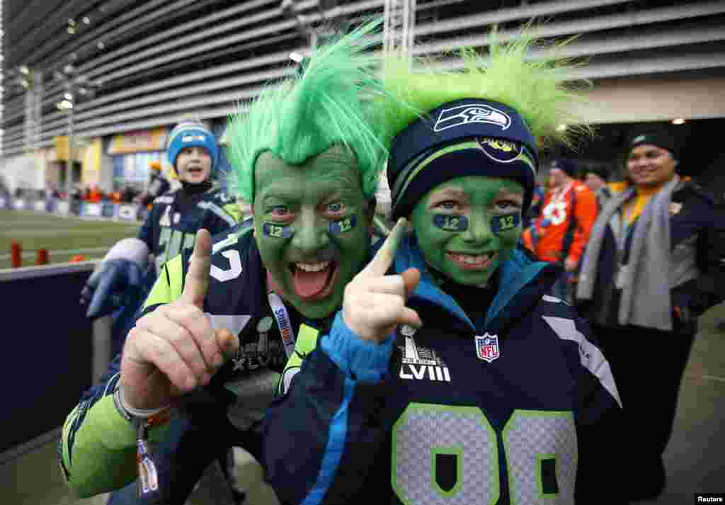 Seattle Seahawks fans Todd Gibson and his son Karsten pose outside the stadium before the start of the NFL Super Bowl XLVIII football game in East Rutherford, New Jersey, Feb. 2, 2014.