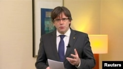 "FILE - Sacked Catalan President Carles Puigdemont makes a statement calling for the release of ""the legitimate government of Catalonia,"" after a Spanish judge ordered nine Catalan leaders to be held in custody, Brussels, Belgium, Nov. 2, 2017."