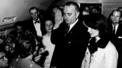Lyndon Johnson is sworn in as president with Jacqueline Kennedy at his side hours after her husband's murder in Dallas