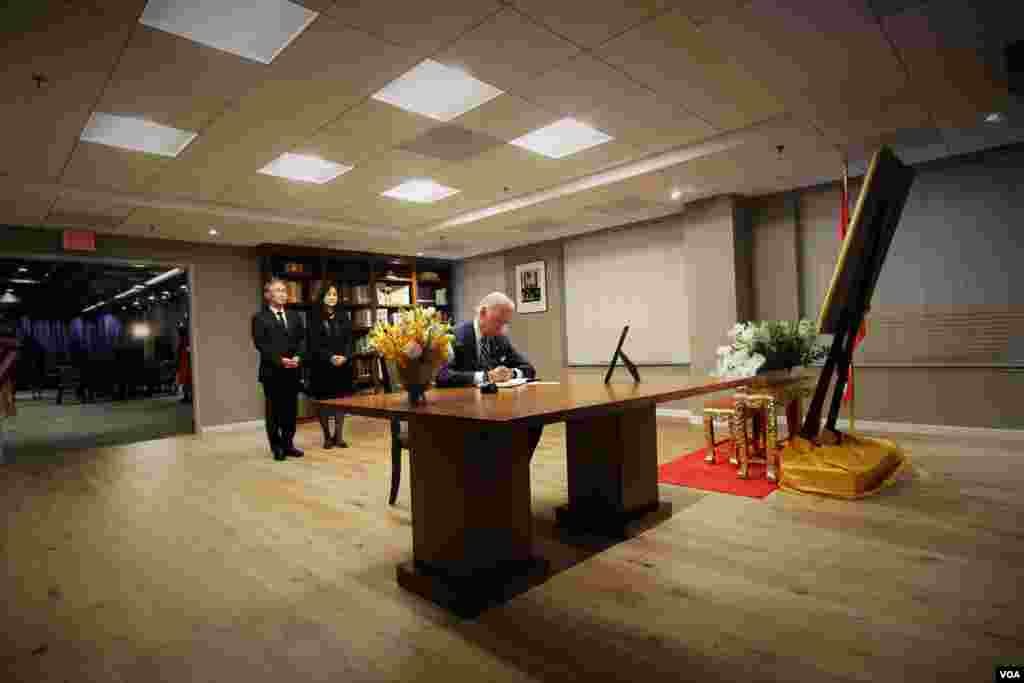 Vice President Joe Biden signs a book of condolences for His Majesty King Bhumibol Adulyadej