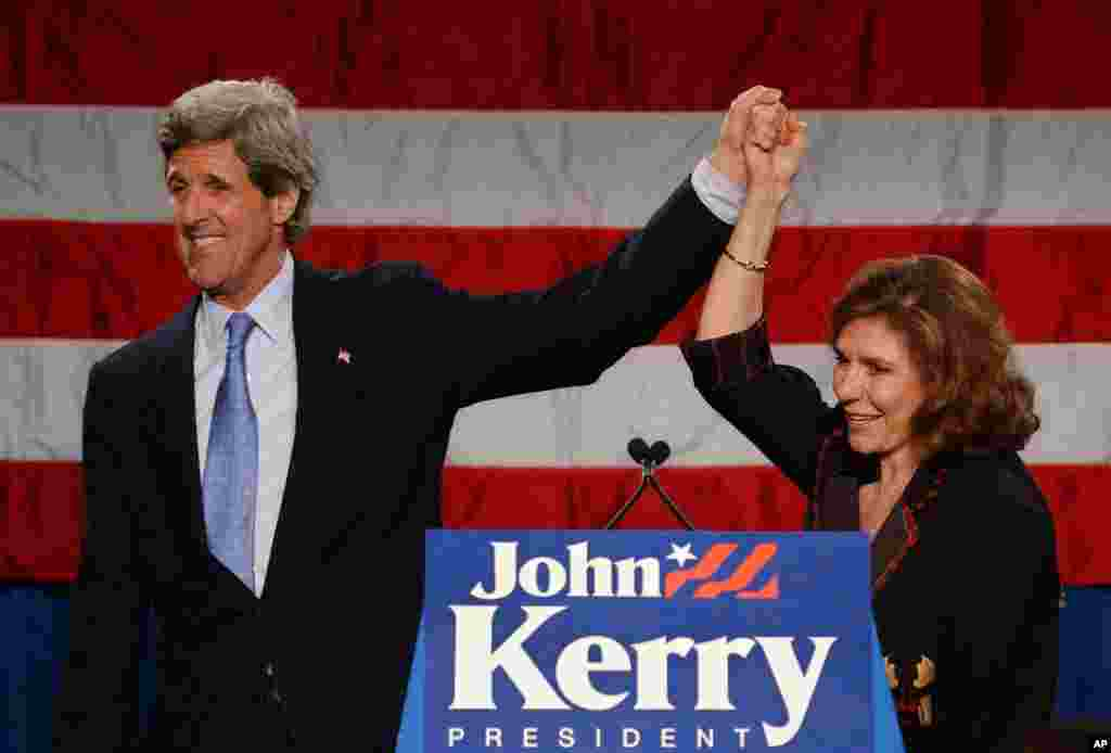 Democratic presidential candidate John Kerry along with his wife Teresa Heinz Kerry greet supporters during a fundraiser when he was the Democratic presidential candidate in Boston, Massachusetts, 2003.