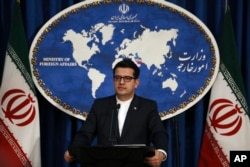 FILE - In this May 28, 2019 photo, Iran's Foreign Ministry spokesman Abbas Mousavi speaks at a media conference in Tehran, Iran.