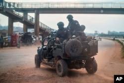 Security forces patrol the streets of Kampala, Uganda, Jan. 14, 2021.