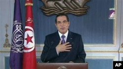 FILE - In this image made from Channel 7 Tunisia TV then-president Zine El Abidine Ben Ali is seen making a speech in Tunis, 13 Jan 2011