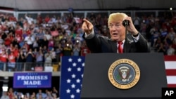 President Donald Trump speaks at a rally at AMSOIL Arena in Duluth, Minnesota, June 20, 2018.