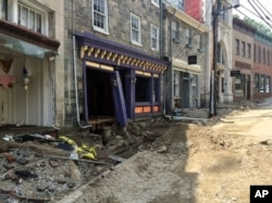 FILE - Damage along Main Street in historic Ellicott City, Maryland, is viewed Aug. 1, 2016, after the city was ravaged by floodwaters, killing two people and causing devastating damage to homes and businesses, officials said.
