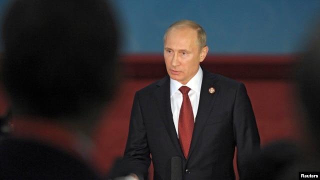 Russia's President Vladimir Putin speaks to journalists after meetings in Shanghai May 21, 2014.