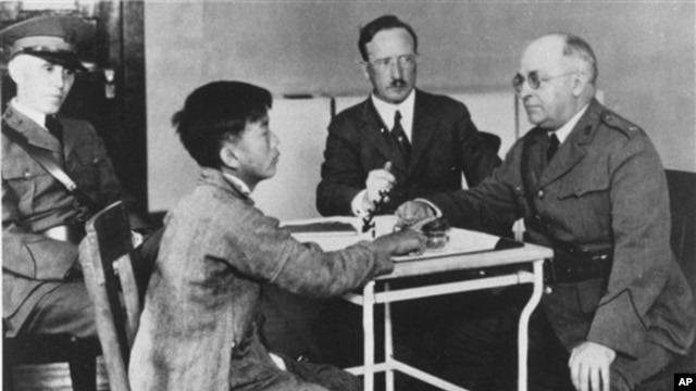 A Chinese immigrant is interrogated at a detention center on Angel Island in San Francisco Bay, Calif., in the 1920's. (AP Photo)