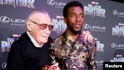 """Stan Lee, left, greets cast member Chadwick Boseman at the premiere of """"Black Panther"""" in Los Angeles, Jan. 29, 2018."""