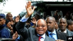 South African President Zuma waves as he arrives to declare his HIV-negative status during launch of the HIV Counselling and Testing Campaign held at Natalspruit Hospital in Katlehong, 25 April 2010