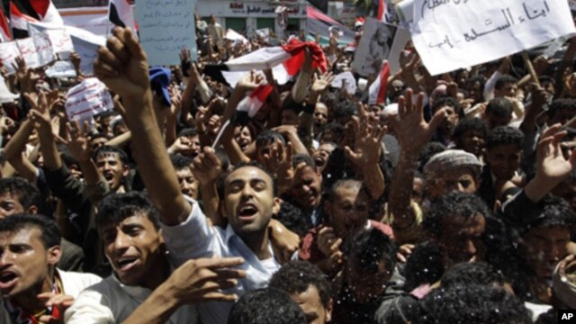 Anti-government protesters shout slogans during a protest demanding the ouster of Yemen's President Ali Abdullah Saleh outside Sana'a University March 1, 2011