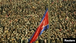 Bendera nasional Korea Utara dikibarkan di Pyongyang pada perayaan Tahun Baru, 1 Januari 2021. (Foto: KCNA/via REUTERS)